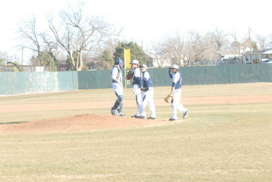 Bulldogs meet at the mound during a recent game. Pitcher Will Bass, second to left, was just one out away from a perfect game during their contest against Odessa at the El Paso tournament. Photo: Homer Marquez/Plainview Herald