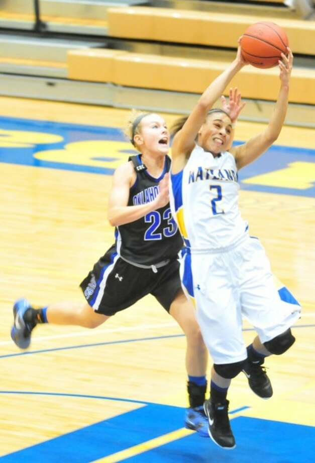 Wayland's Angeleigh Davis (2), a sophomore from Austin, puts up a shot on a fast-break as Oklahoma City's Emily Davis (23) goes for the block in Thursday's game in Hutcherson Center. After losing that game, the Queens bounced back on Saturday afternoon against Mid-America Christian. Photo: By KEVIN LEWIS