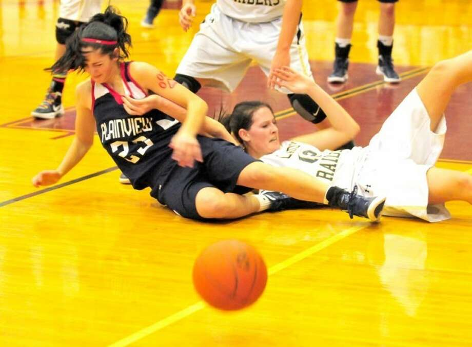 Plainview freshman Karli Wheeler (left) falls to the floor with a Wichita Falls Rider player after forcing a turnover in Monday's bi-district game in Vernon. Wheeler and Laura Castillo combined for 40 points as Plainview won in overtime 61-51. An area round game, likely against unbeaten and No. 6 El Paso Chapin, awaits, tentatively set for 7:30 p.m. Friday at Odessa College. Photo: Doug McDonough/Plainview Herald