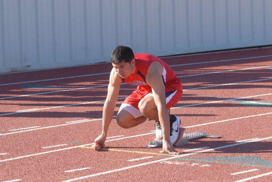 Bulldog trackster Isaiah Carasco gets set during Plainview opening track meet in Frenship. Photo: Homer Marquez/Plainview Herald