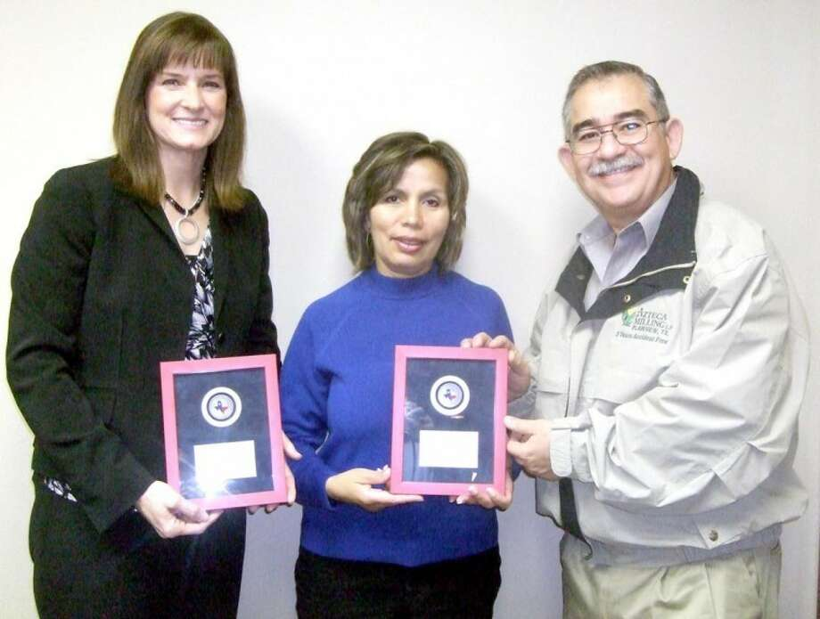 Kevin Lewis/Plainview HeraldSandra Aven (left) and Ofelia and Gabriel Martinez were honored as Volunteers of the Quarter by the Plainview Chamber of Commerce. Aven is a past officer of the Chamber board and was active in all facets of the organization, while the Martinezes assisted with the Chamber-sponsored Hale on Wheels Bike Ride.