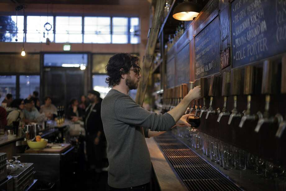 Bartender Ryan Shevlin, right, serves Shmaltz beer during a benefit for the Institute for Myeloma and Bone Cancer Research at the Magnolia Brewing Company in San Francisco, Calif., on Wednesday, January 20, 2016. Photo: Carlos Avila Gonzalez, The Chronicle