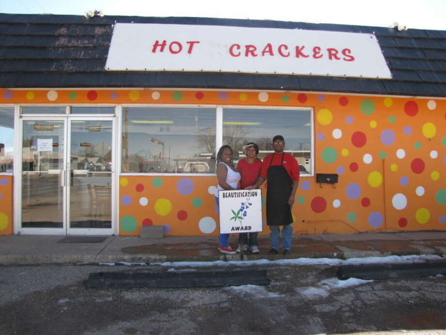 Letti Cheyne/Pitch In PlainviewHot Crackers in the 1000 block of Quincy received this month's Beautification Award from Pitch In Plainview. The business is represented by Brittaney (left), Ruby and James Walzier.