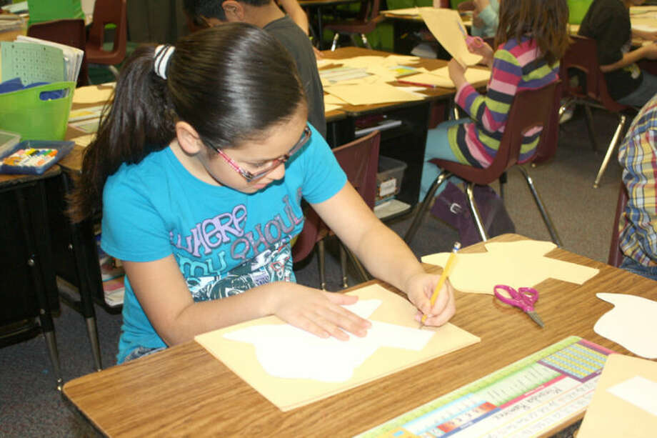 Jan Seago/Plainview ISDLa Mesa student Miranda Ramirez traces an outline of Texas as part of a lesson on Texas history. Schools across the district are planning special activities for parents and community during Texas Public School Week, March 4-8. Miranda is a student in Vickie Stokes' second grade class.