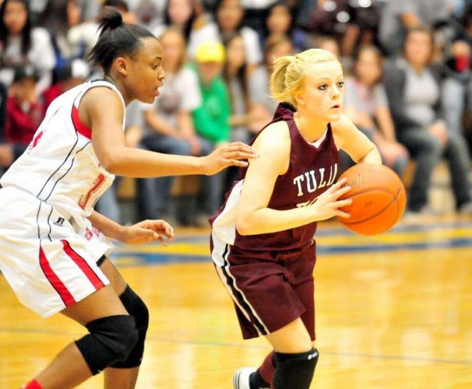 Tulia's Bailey Rousseau (right) prepares to pass to a teammate as Slaton's Shaquilla Felton defends during Friday's Class 2A area round playoff game in Hutcherson Center. After being tied at halftime, Tulia won 61-38 to set up a regional quarterfinal game against Idalou at 6 p.m. Tuesday back at Hutcherson Center. Photo: Kevin Lewis/Plainview Herald