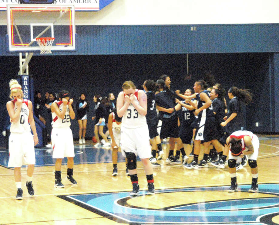 As the Lady Huskies of El Paso Chapin celebrate victory in the background, Plainview Lady Bulldogs Kristian Reynolds (0), Michelle Portillo (22), Taivia Hearn, Bailey Davis (33) and Laura Castillo show their dejection. Plainview lost 46-43 Friday in the area round of the playoffs in Odessa after Chapin's Samantha Alvarez made a 30-foot shot at the buzzer. Photo: Doug McDonough/Plainview Herald
