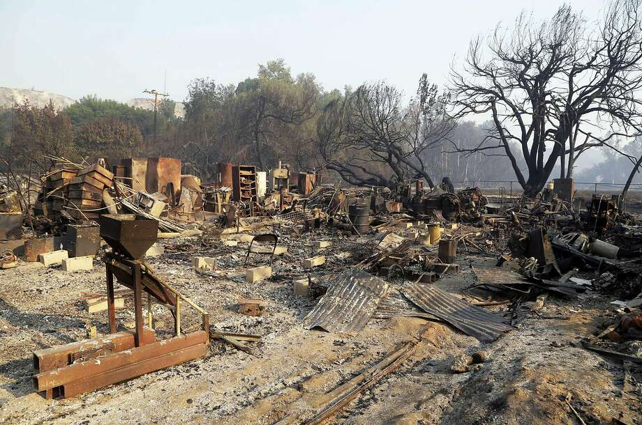 Torched debris litters Sable Ranch in Santa Clarita. The ranch had Old West-style buildings used for movie productions. Photo: Nick Ut, Associated Press