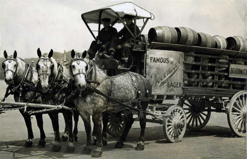 Beverwyck Lager beer wagon 3 horse hitch July 17, 1933, in Albany, N.Y. The brewery reopened in 1933 with the launch of a new lager. They also used trucks for delivery - something new for the new beer. The stables held 40 horses in 1884. (Times Union archive)