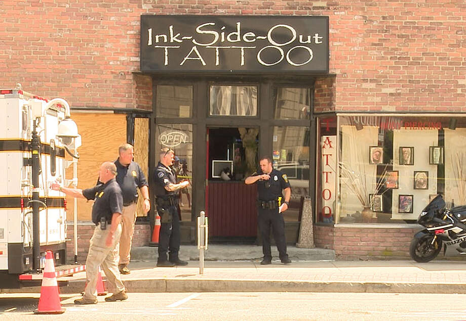 Police investigate a shooting at Ink Side Out Tattoo at 47 Wall St. Monday afternoon. Photo: Harold F. Cobin
