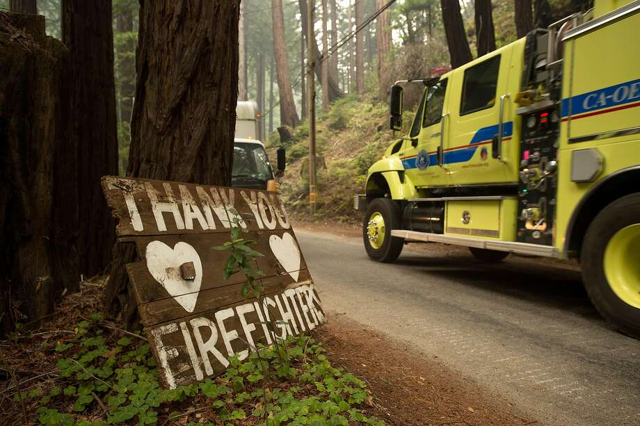 A fire truck battling the Soberane Fire passes a sign on Palo Colorado Rd. on Monday, July 25, 2016, in Big Sur, Calif. Photo: Noah Berger, Special To The Chronicle
