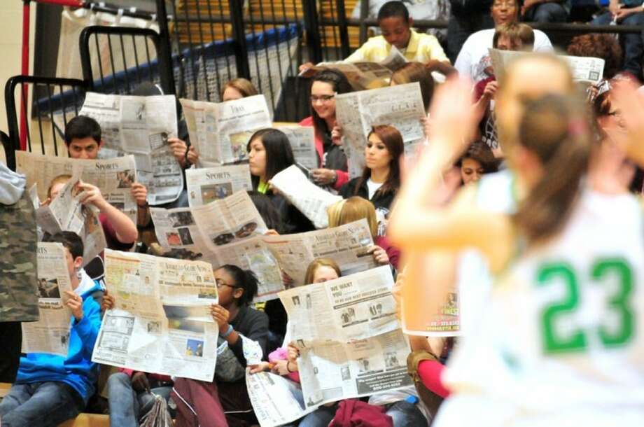 Kevin Lewis/Plainview HeraldTulia Lady Hornet fans pretend to read the newspaper while the Idalou Lady Cats are introduced prior to the teams meeting in a Class 2A regional quarterfinal game Tuesday at Hutcherson Center. Tulia won to advance to the regional tournament in Midland. (See story, related photo on Page 9A.)