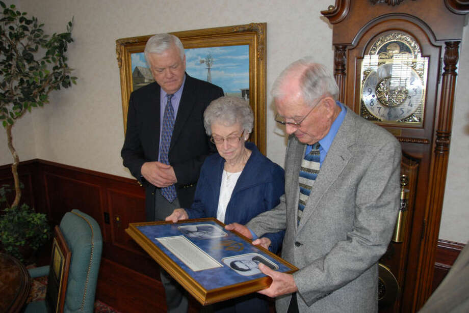 "The Robert and May Montague Garrett Endowed Scholarship, given by Roberta and Bill Hardin of Floydada, was acknowledged during their visit to the Wayland campus on Thursday. Dr. Paul Armes (left), president, makes the presentation of a plaque that will hang in Wayland's Hall of Honor in McClung University Center. At right is Director of Alumni Development Danny Andrews who presented the Hardins a shadowbox replica of the plaque and a Kenneth Wyatt print of university founder Dr. James H. Wayland making his ""House Call."" Photo: Wayland Baptist University Photo"