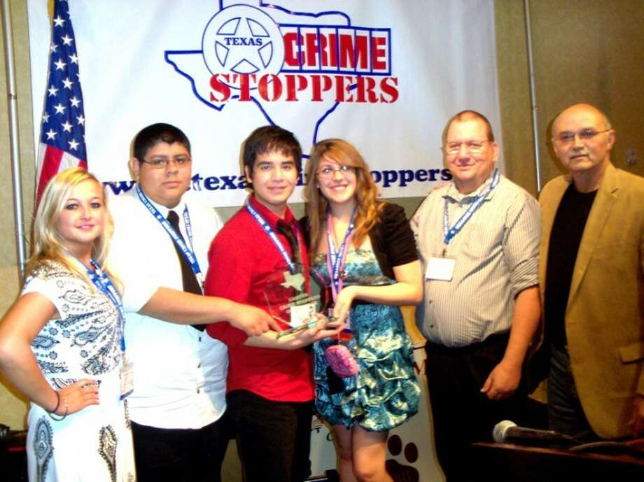 Courtesy PhotoCharles Hamilton (right) of the Texas Crime Stoppers Board of Directors presents the Campus Crime Stoppers of the Year Award to the Plainview Student Crime Stoppers, represented by sponsor Brittani Brownlee (left), Greg De La Cerda, Victor Vasquez, Destiny Talley and local Student Crime Stoppers Coordinator Terry Nelson.