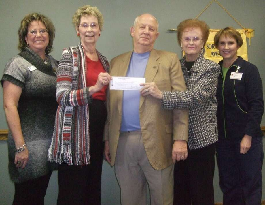Kevin Lewis/Plainview HeraldTo insure the future stability of the Happy Feet program, the James and Eva Mayer Foundation, represented by trustee David Wilder, present a donation to co-chairs Helen Hogge and Peggy Wall (center). Also shown are Amanda Curry (left), Soroptimist president, and Charlotte Adams (right), PISD school nurse. For 18 years the program has depended on local contributions to purchase shoes, socks and emergency clothing for students in Plainview ISD.