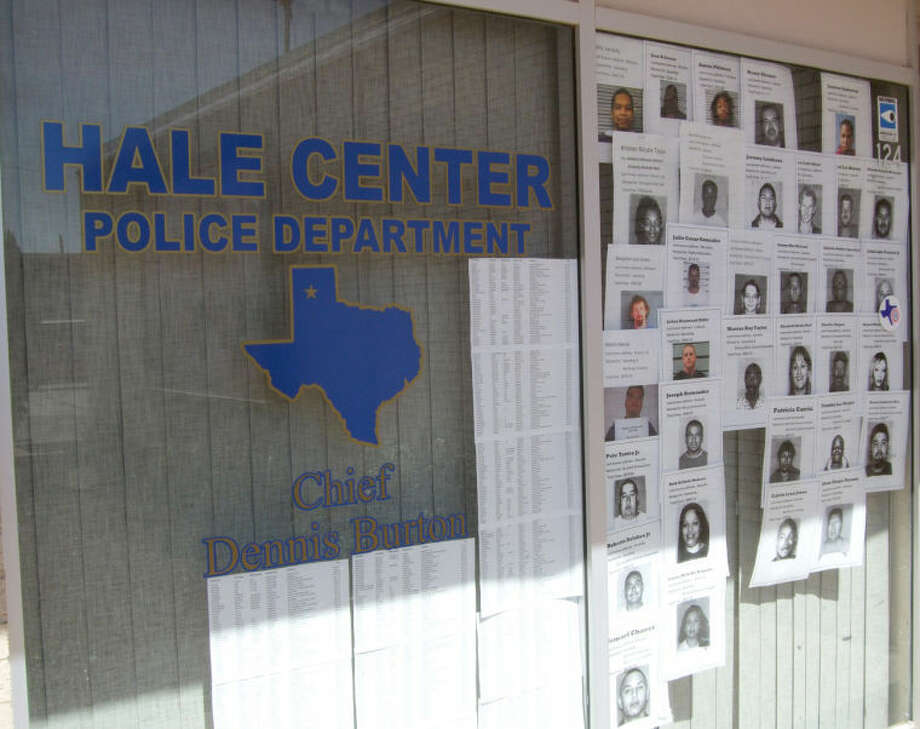 A rogues' gallery is shown outside the Hale Center Police Department. The department recently participated in the Great Texas Warrant Roundup, aimed at getting those with outstanding warrants to come in and pay their fines or serve their time. Due to the HCPD patrolling I-27, Police Chief Dennis Barton said many of those with traffic fines unsettled are from outside of Hale Center. Photo: Shanna Sissom | Plainview Herald