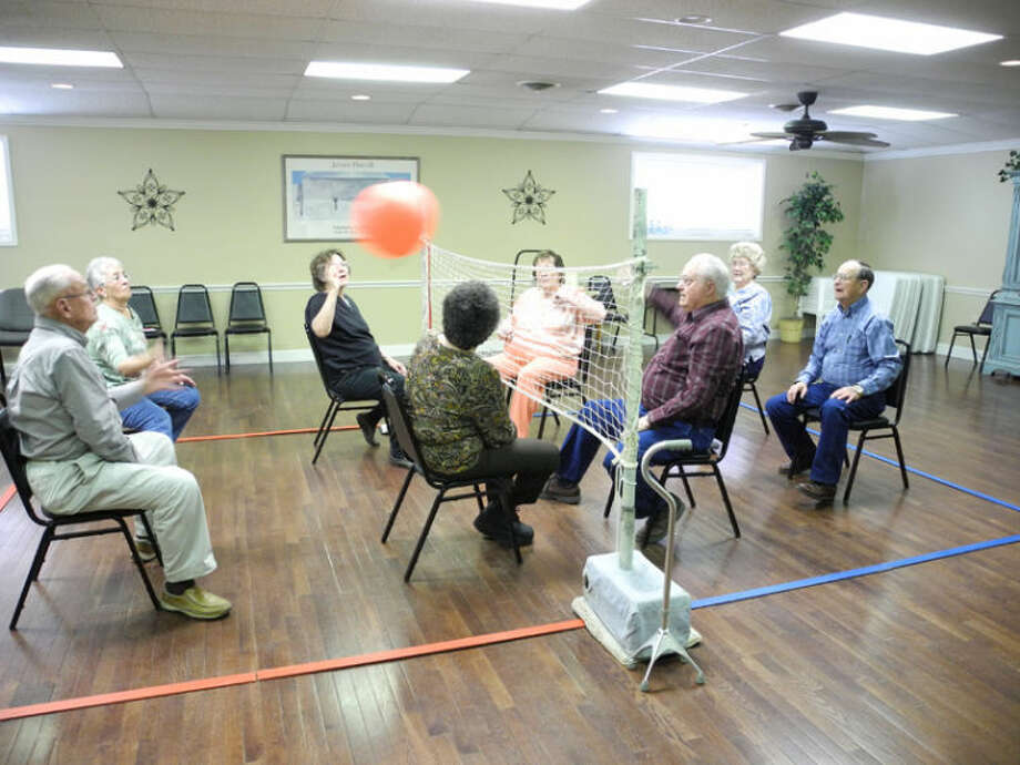 Balloon volleyball is a fun group activity at the Hale County Senior Citizens Center. The ball often volleys back and forth several times before it comes to rest.Balloon volleyball is a fun group activity at the Hale County Senior Citizens Center. The ball often volleys back and forth several times before it comes to rest. Players include Maurice Johnson, Gaynell McLemore, Marvin Graham, Cleva Little, Bo Blankenship, Frances Sawaya, Synthia Taylor and Alice Rey. Photo: Gail M. Williams | Plainview Herald