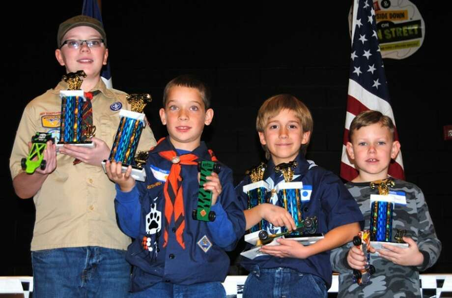 Doug McDonough/Plainview HeraldFirst-place finishers in the Haynes District Pinewood Derby on Saturday were Zack Collie (left) of Pack 252 in Plainview, Webelos; Brett Heitschmidt, Pack 265, Nazareth, Tiger Cub; Kenon Riley, Pack 206, Plainview, Bear; Eric Matthews, Pack 206, Plainview, Wolf; and Christopher Rios (not shown), Outlaw Division. Riley also won King of the Ramp.