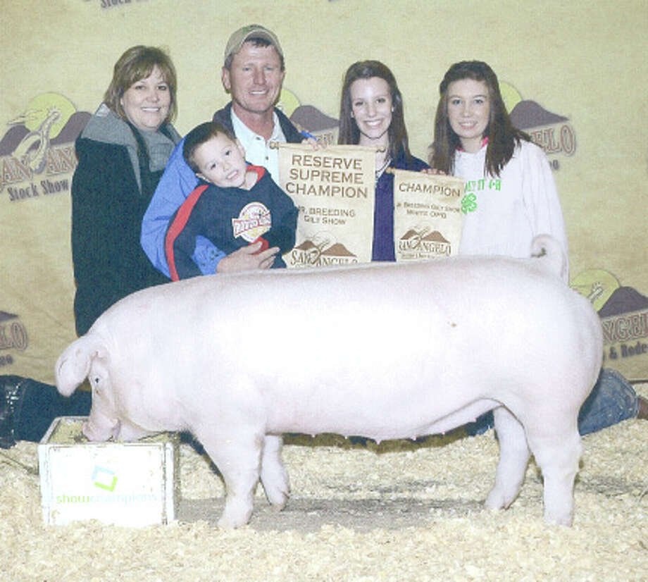 Courtesy PhotoHale County 4-H member Shalin Lawson (second from right) exhibited the Champion White Other Pure Breeds pig, which also was Reserve Supreme Champion at the San Angelo Breeding Gilt Show. That contest is part of the San Angelo Stock Show and Rodeo. She is a freshman at Plainview Christian High School. Shown with Lawson are her parents, Leonard and Shelli Lawson, brother Will and classmate Bailey Reese.