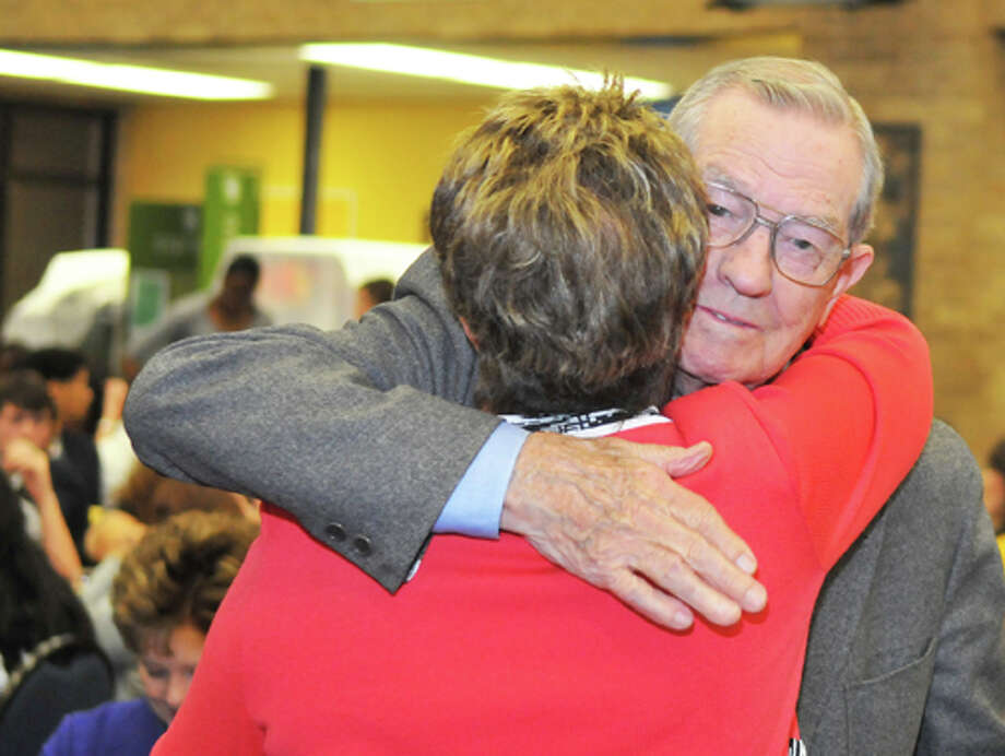 Legacy Leadership Award honoree Harley Redin hugs former Wayland student and Texas Tech Lady Raider coach Marsha Sharp, who served as keynote speaker for Friday's High Plains Leadership Summit at which Redin was honored.
