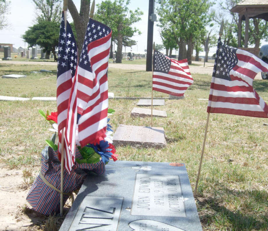 Miniature flags were placed Friday and Saturday at the graves of veterans at Plainview Cemetery and Memorial Gardens. The Memorial Day ceremony honoring these veterans will be 10 a.m. Monday at the cemetery gazebo. Photo: Jessica Thornton/Plainview Herald