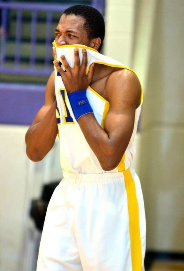 Hale Center senior Tyrell Johnson reacts after the Owls' 50-48 loss to No. 14 Vega in the Class 1A Division I regional quarterfinals on Tuesday in Dimmitt. Photo: Albert Gomez