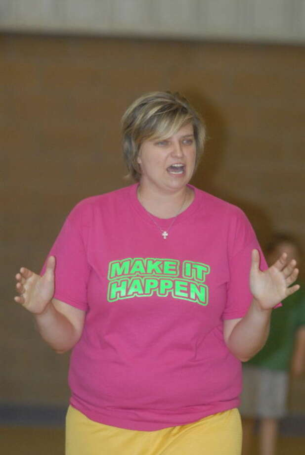 Plainview Christian Academy girls basketball coach and athletic director Andra French, shown making a point during the PCA basketball camp Thursday morning, was named the TAPPS Class 1A Coach of the Year. She will receive her award next Friday in San Antonio. Photo: Skip Leon/Plainview Herald