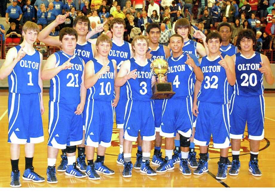 Olton Mustangs with their Class 1A Division I regional quarterfinal trophy.