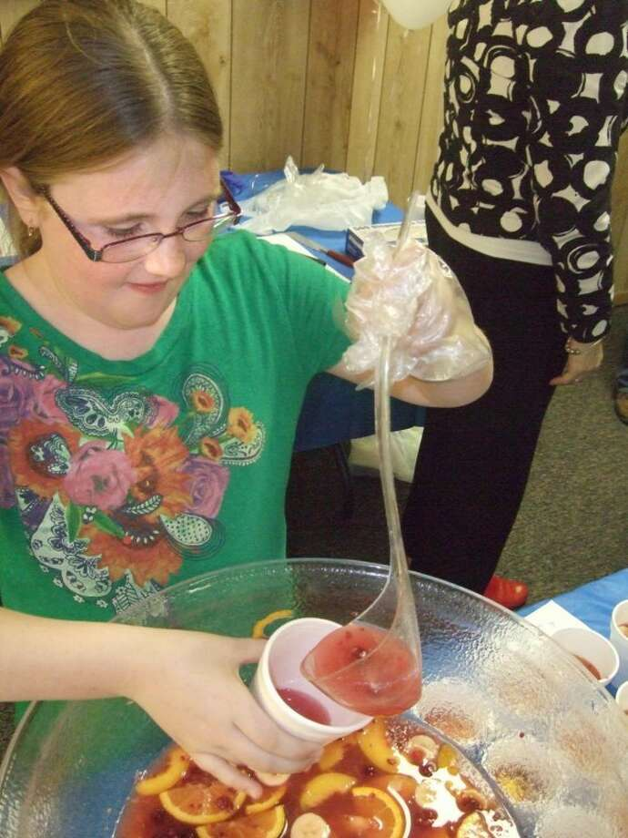 In this 2011 file photo, Hale County Jr. 4-H member Cortney James, 10, pours a cup of punch during the hk2020 Kid's Cooking School as part of the annual Taste of Plainview on Thursday evening at the Ollie Liner Center. More than 500 people attended the event, which featured food from a dozen local food establishments. Photo: By KEVIN LEWIS