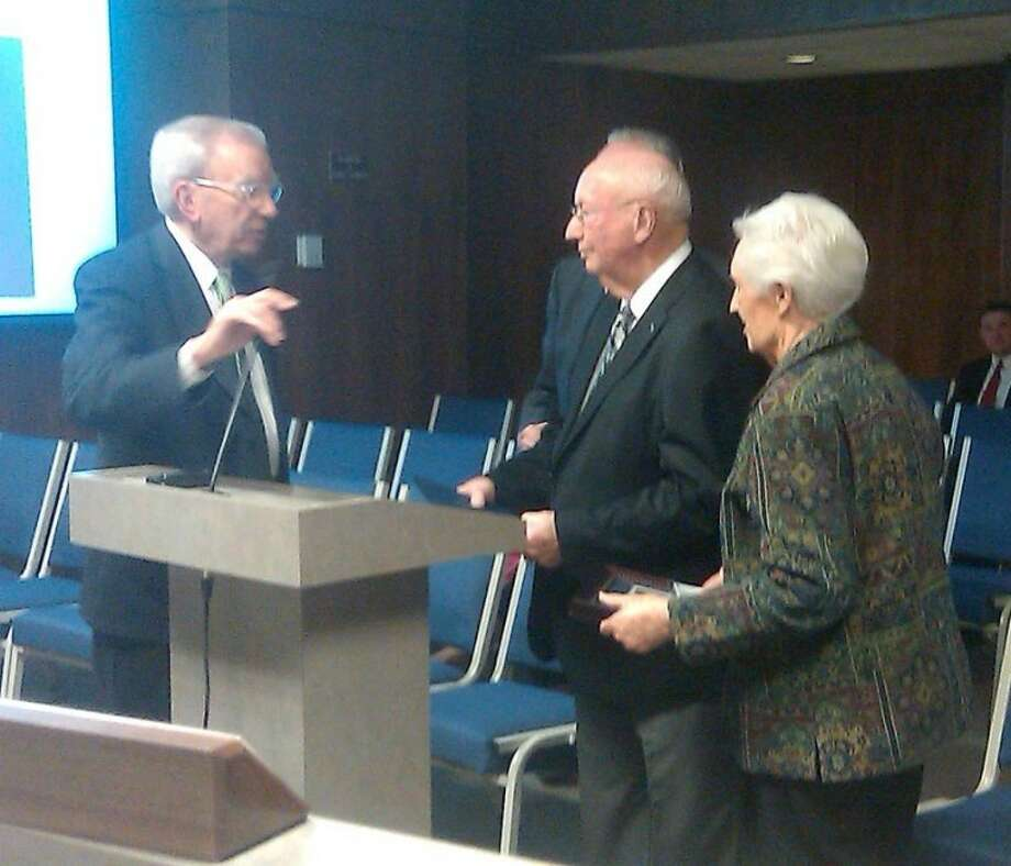 Courtesy Photo by Charles StarnesPlainview Mayor John C. Anderson (left) presents a key to the city to Norman and Louise Wright in recognition of Norman's longtime service representing Plainview on the board of the Canadian River Water Municipal Authority. Wright served six years as president and 10 years as vice president.