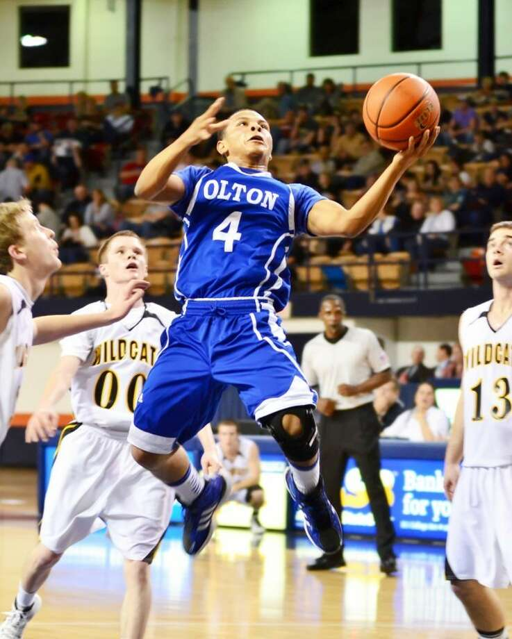 Olton's Torey Jimenez floats through the air against Canadian. Photo: Albert Gomez