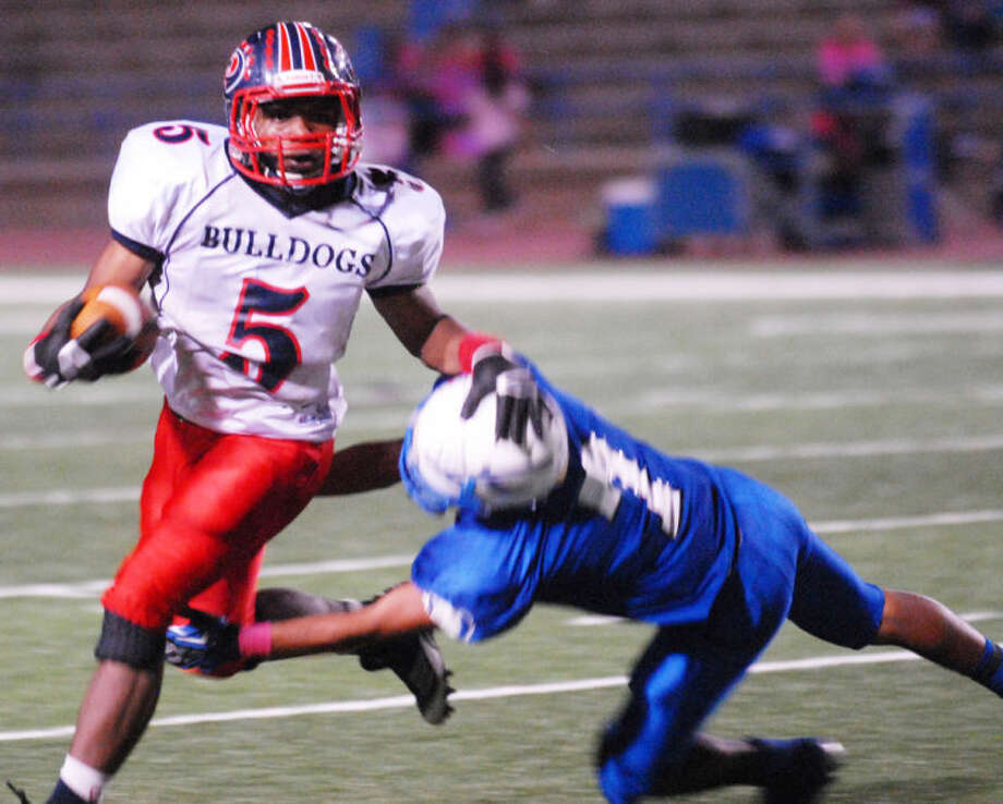 Daniel Miller (5) runs for some of his 815 yards in this file photo from the 2012 football season. Miller has verbally committed to attend Eastern New Mexico University in the fall and play football for the Greyhounds, who compete in the Lone Star Conference. Photo: Homer Marquez/Plainview Herald