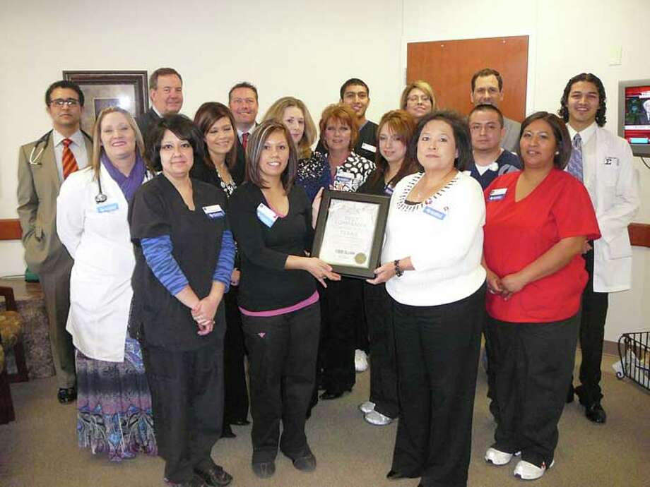 Roijon Johnson/Plainview HeraldUMC Physicians Network Services recently was named by Texas Monthly as one of the top 100 medium-sized companies to work for in Texas, coming in at 23rd. Also, UMC came in third among large companies. UMC CEO Paul Acreman (back row, second from left) attended a celebration at Plainview's UMC PNS Family Medical Care to present a plaque for the award. It's the second year for PNS to receive the honor. The Plainview clinic and Molly DeLeon were nominated by the PNS corporate office to represent Family Medical Care at an awards ceremony in Austin.
