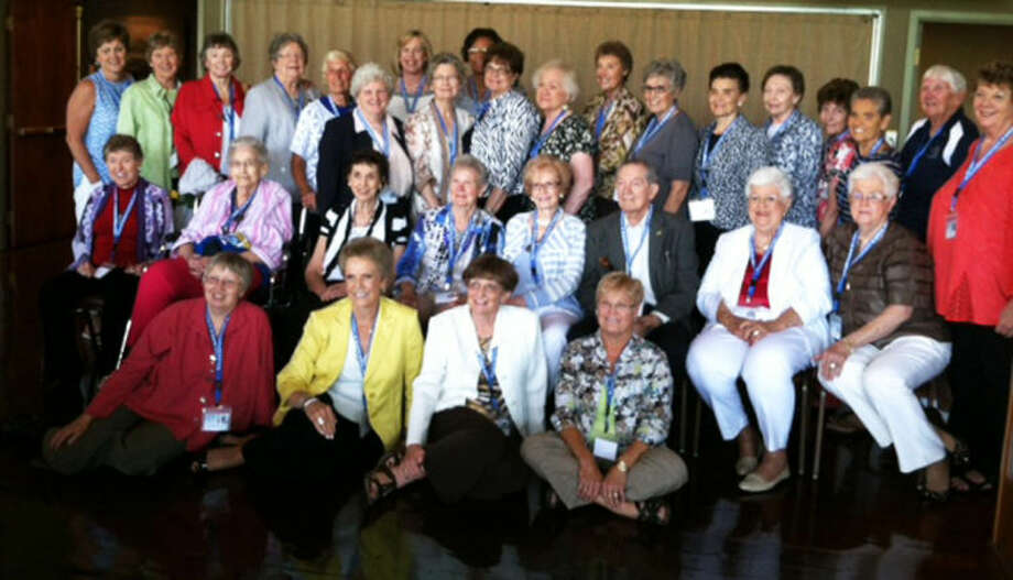 Members of the Flying Queens basketball teams from 1953-58 were inducted into the National Women's Basketball Hall of Fame as Trailblazers of the Game Saturday night. Twenty-one of the 25 living members of those teams are shown here along with other former players, former coach Harley Redin and his wife, Wilda Hutcherson Redin, at a luncheon at the Hall of Fame in Knoxville, Tenn., Saturday. Photo: Danny Andrews/Wayland Baptist University