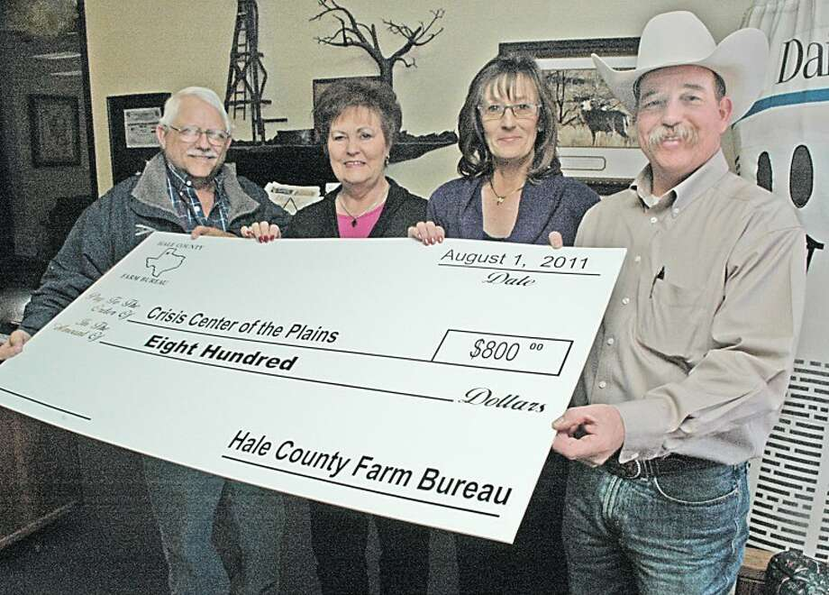 Gordon Zeigler/Plainview HeraldKerry Winders (right), agency manager at Farm Bureau Insurance of Plainview, and Weldon Melton (left), president of the Plainview Farm Bureau organization, present a check for $800 to benefit Crisis Center of the Plains. Accepting the check are Kay Harris (left), executive director of CCOP, and Marci Brown, victim services coordinator.