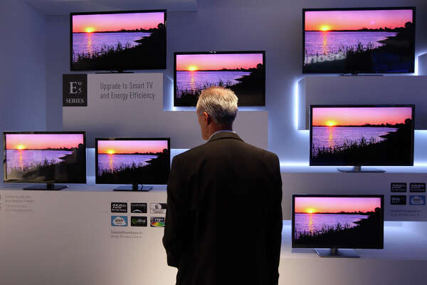 BERLIN, GERMANY - AUGUST 31: A visitor looks at Panasonic ETW5 energy efficient Smart TV flat-screen televisions at the Internationale Funkausstellung (IFA) 2012 consumer electronics trade fair on August 31, 2012 in Berlin, Germany. IFA 2012 is open to the public from today until September 5.  (Photo by Adam Berry/Getty Images)