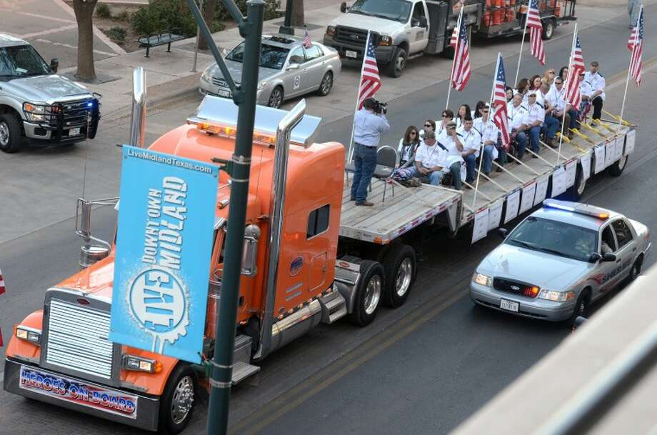 A flatbed truck carrying wounded veterans and their families, seen here at the start of a parade, was struck by a train Nov. 15, 2012 on Garfield in Midland. James Durbin/Reporter-Telegram