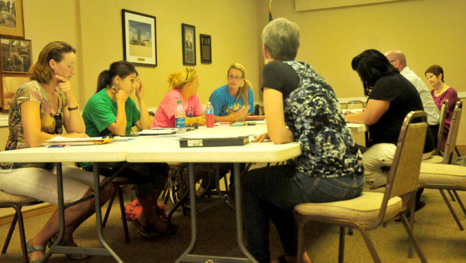 Members of the Hale County Dairy families plan for the seventh annual Red, White and Moo Milk Fest during their weekly meeting. Above Bernadette Mulliken (right) of Vista Grande takes the floor as Christina Ruyne (left) of Dairy Fountain, Tori Lujan of Southwest Dairy Farmers, Alex Milliken and other members of the committee add input. Photo: Homer Marquez/Plainview Herald