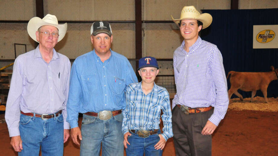 For the Dawson family, there was no better place to spend Father's Day weekend then in the pens of the 2013 Parade of Breeds livestock show in Plainview. Three generations of the family worked the show, including Murray Dawson (left), son Michael and grandsons Jake and Travis. Not pictured is grandson Matt Dawson. Photo: Homer Marquez/Plainview Herald