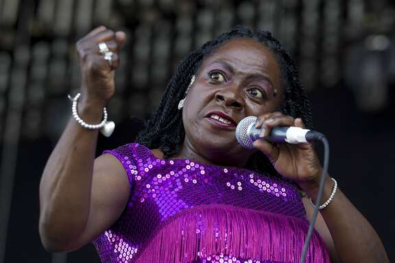 "FILE - This June 8, 2012 file photo shows soul singer Sharon Jones of Sharon Jones and The Dap-Kings performing during the Bonnaroo Music and Arts Festival in Manchester, Tenn. Jones is the focus of a new documentary, ""Miss Sharon Jones!"" that captures the stark difference between life on and off stage for the dynamic soul singer most often compared to James Brown. In 2013, Jones was diagnosed with stage-two pancreatic cancer. The film documents her transformation into cancer patient and, ultimately, back into a full-throated force. (AP Photo/Dave Martin, File)"