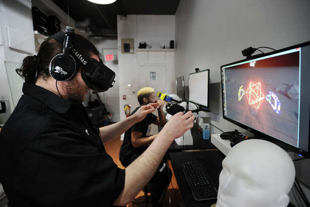 Manager Stephen Vermilyea, of Norwalk, demonstrates the Oculus Rift virtual reality technology at Industrial C.H.I.M.P. at 132A Washington Street in Norwalk.