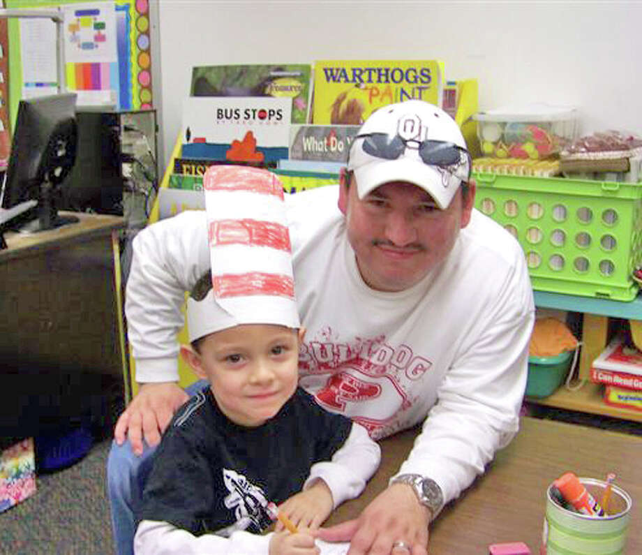 "Courtesy PhotoThunderbird student Tristan Rodriquez wears a ""Cat in the Hat"" style headpiece while working on an activity with his father, Abel Rodriquez. Thunderbird kindergartners joined children across the nation in celebrating Read Across America Day on Friday. The day marks the birthday of children's author Dr. Seuss. Thunderbird kindergarten teachers are Heather Glenn, Jeremy Douglas, Angela Clawson and Samantha Salas."