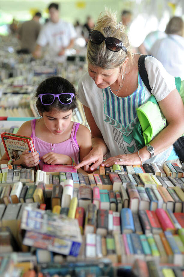 Amy Calandriello and her daughter Madison, of Fairfield, browse for books at he Pequot Library's 56th annual summer book sale. , in Fairfield, Conn. July 22, 2016. Photo: Ned Gerard / Hearst Connecticut Media / Connecticut Post