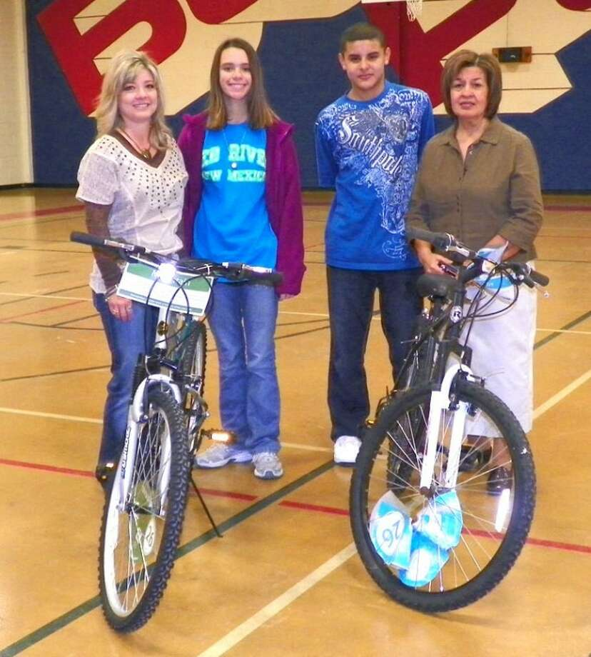 Coronado Junior High students Breanne Roden and Nathanial Armijo are pictured with Rotarians Kim Street (left) and Lydia Castillo after being presented bikes as part of the Plainview Rotary Club's perfect attendance contest. Winners at other campuses for the most recent six-week grading period were: Lakeside, Abraham Molina and Lizzie Terry; Houston School, Forrest Keller; Estacado, Roy Abanonu and Lizette Najera; Ash, Sabrina Castillo and Alexis Perez; and PHS, Alyssa Gonzales, Uriah McIntee and Hayden Walter.