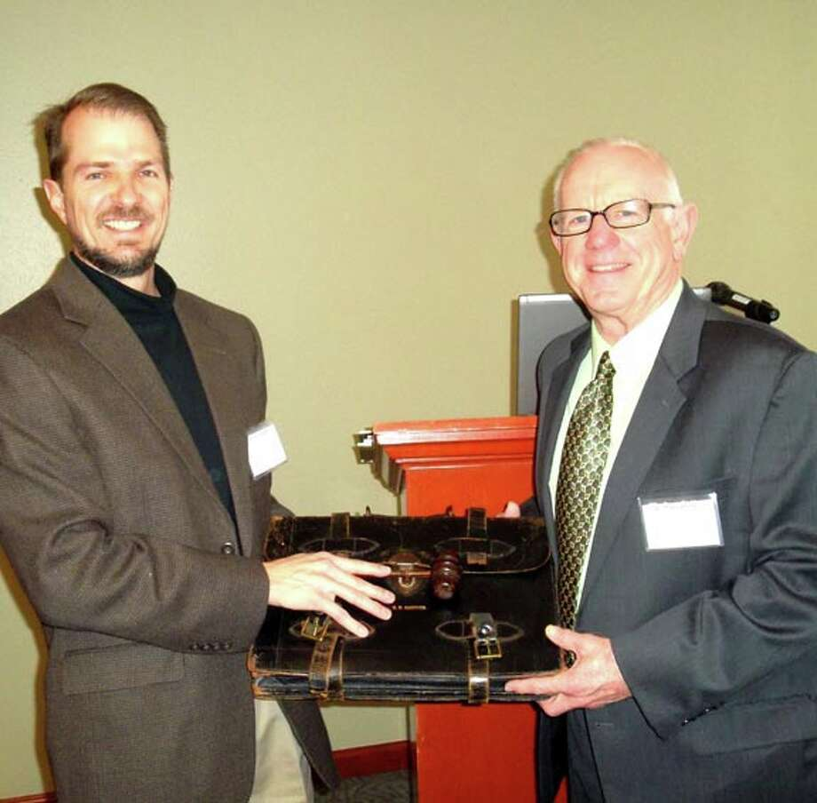 Courtesy PhotoAt a recent Conference of College Teachers of English at Texas Wesleyan University in Fort Worth, Dr. Brent Gibson (left) of University of Mary Hardin-Baylor, CCTE president for 2011-12, passes the gavel and briefcase to Dr. Arch Mayfield of Wayland, incoming CCTE president for 2012-13. / COPYRIGHT,2011