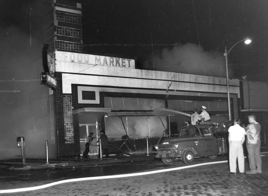 Herald File PhotosIn a futile effort, firefighters pour water into the inferno that consumed the Stop and Shop Super Market on Oct. 15, 1961. Damage was set at $150,000 to $200,000 — about $1.5 million today.
