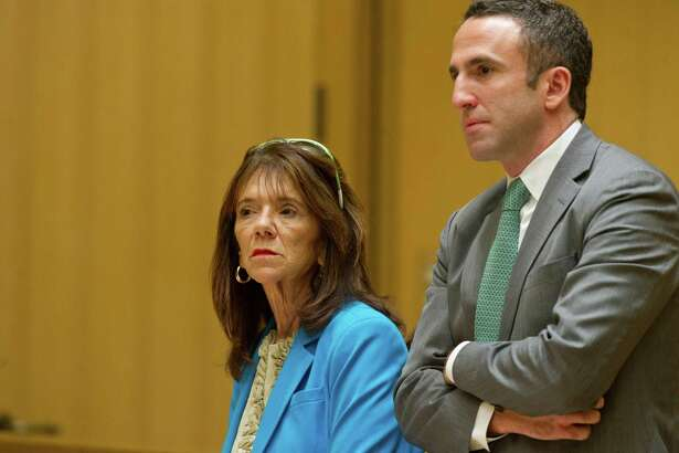 Former Stamford High School Principal Donna Valentine, is arraigned at State Superior Court in Stamford, Conn., on Wednesday, October 8, 2014, with her attorney, Mark Sherman, for allegedly failing to report a sexual relationship between teacher Danielle Watkins and an 18-year-old student.