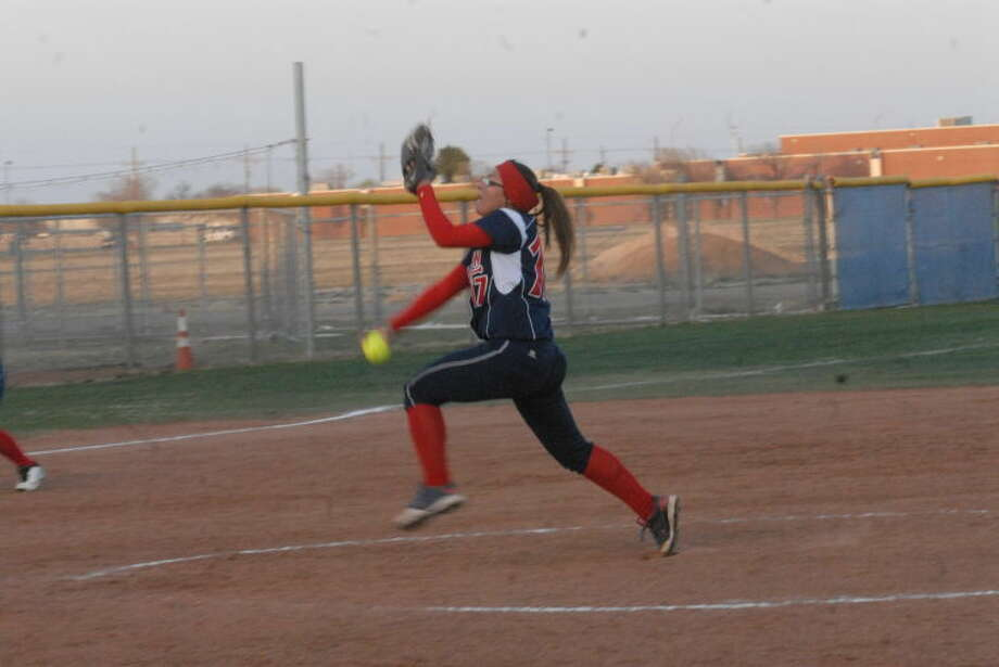 Lady Dog pitcher Monica Perez throws the heat at a recent game. The Plainview girls take on second place Monterey Friday at Lady Dog field. Photo: Homer Marqeuz/Plainview Herald