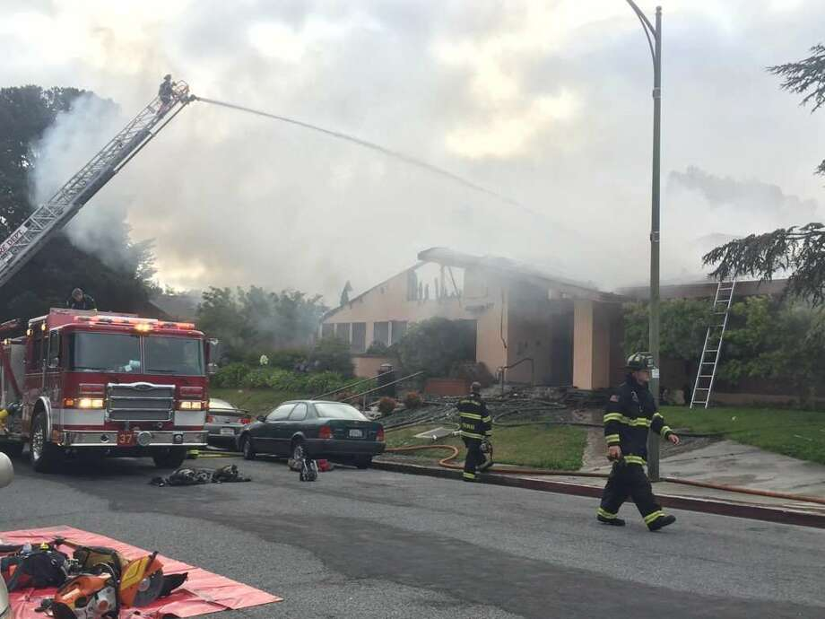 Dozens of firefighters battled an early morning blaze Thursday that destroyed the Millbrae Community Center. Photo: Kevin Schultz / The Chronicle