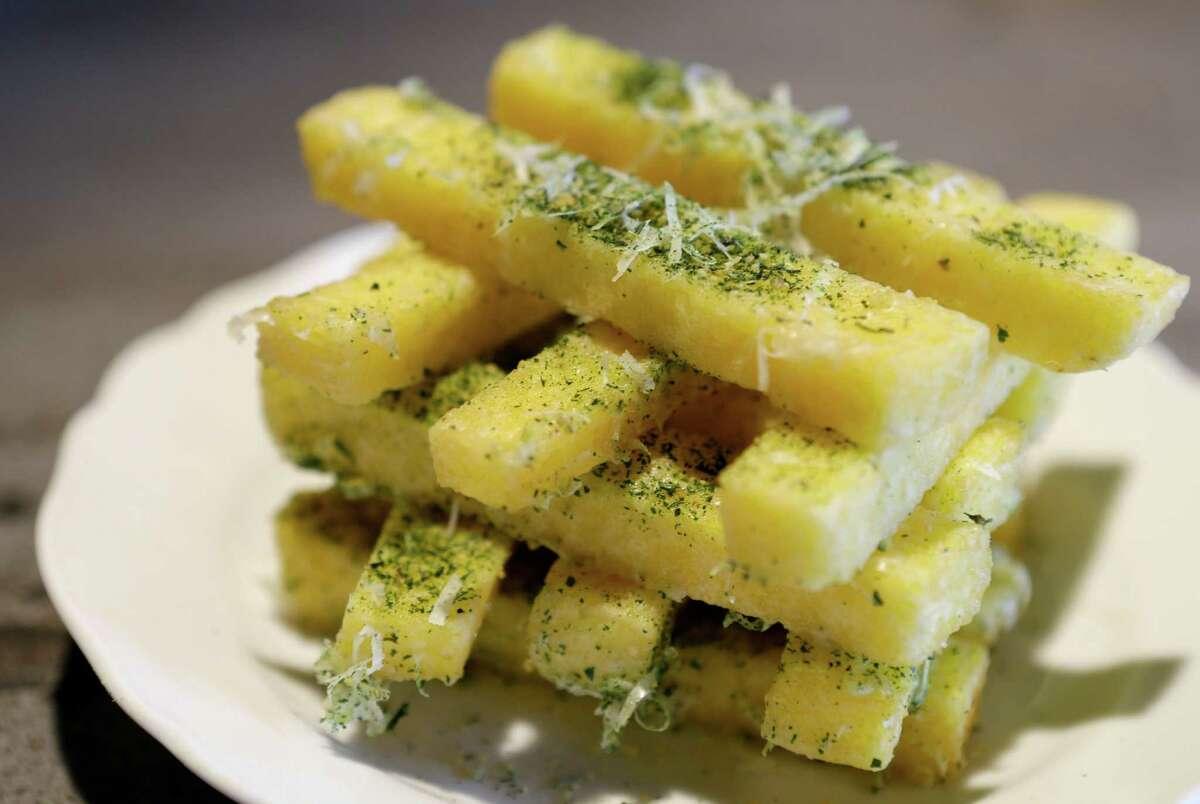 Polenta fries are shown at Arthur Ave Italian American, 1111 Studewood.
