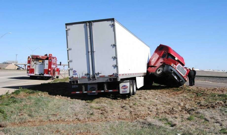 Doug McDonough/Plainview HeraldAn unexpected gust of wind about 10:45 a.m. Monday caused an 18-wheeler on Interstate 27 to jackknife south of the Cargill Meat Solutions. Driver Cedo Ivkovic, 59, of Nevada was not injured. However about 50 gallons of diesel fuel spilled from the Freightliner tractor, which prompted a response from the Plainview Fire Department and state water quality officials. Ivkovic said he was traveling north on I-27 in a truck belonging to Cavrag Transport of Salt Lake City, Utah, when a gust of wind caused the empty trailer to whip around unexpectedly and his truck to jackknife. Ivkovic said he was thankful there wasn't any other vehicles involved in the mishap. According to the Texas Tech Mesonet website, Plainview was experiencing westerly wind gusts of up to about 30 mph at the time of the mishap.